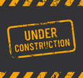 Under construction rubber stamp with the text Stock Images