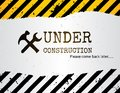 Under construction sign grunge background with crossed hammer and wrench Royalty Free Stock Images