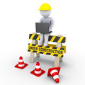 Under construction sign and a worker with laptop d is sitting on an Royalty Free Stock Images