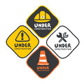 Under construction signs set in cartoon style Royalty Free Stock Photo