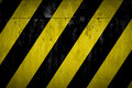 Under construction yellow and black paint metallic background Royalty Free Stock Photos