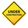 Under construction yellow sign Royalty Free Stock Photo