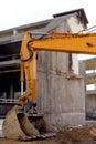 Under destruction excavator on a building site Stock Photo
