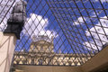 Under the louvre pyramid sky in paris is a of glass and metal in middle of cour napoléon Royalty Free Stock Images