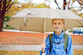 Under the rain schoolboy with umbrella Stock Image