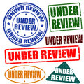 Under review stamp set of grunge rubber stamps with the text written inside vector illustration Stock Image