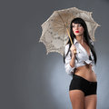 Under the umbrella young beautiful woman holding a bright Stock Image