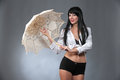Under the umbrella young beautiful woman holding a bright Stock Images