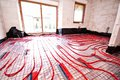 Underfloor heating being installed in a house under construction Stock Photography