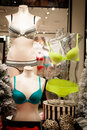 Undergarments for sale mannequins wearing colorful bras and underwear in a store display Stock Photos