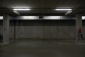 Underground parking garage dark empty spaces Stock Photography