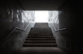 Underground passage with stairs in the glowing end Royalty Free Stock Photography