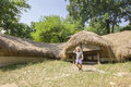 Underground traditional romanian house kid exploring with hay roof in open air village museum in bucharest romania Stock Images