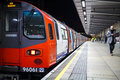 Underground train at station london boarding Stock Photography
