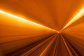 Underground tunnel streight with orange light and rail Royalty Free Stock Images