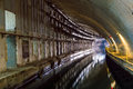 Underground tunnel with water illuminated for passage and repair submarines Royalty Free Stock Photos