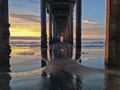 Underneath beach pier at sunset with colorful sky la jolla ca under scripps under a southern california Stock Photos