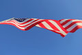 Underneath a united states flag blowing in breeze Royalty Free Stock Photos
