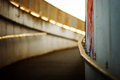 Underpass flooded by the sunset with shallow focus on graffiti Royalty Free Stock Photography