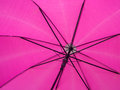 Underside of a pink umbrella Royalty Free Stock Photo