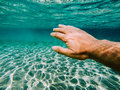 Underwater dive swimmer hand exploring world sea Stock Photos