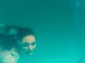 Underwater girl in swimming pool Royalty Free Stock Photo