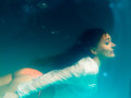 Underwater girl wearing bikini in swimming pool leisure relax and active lifestyle concept and diving Royalty Free Stock Photography