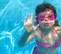 Underwater little girl blue swimming pool Stock Image