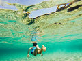 Underwater nature study boy snorkeling in clear blue sea Stock Image