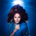 Underwater photo pretty young girl with dark long hair wearing b blue fabric Stock Photos