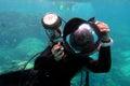Underwater photographer photographing underwater Royalty Free Stock Photo