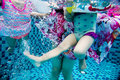 Underwater pohto of legs of the Asian Chinese family Royalty Free Stock Photo