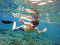 Underwater shoot of a young boy snorkeling Royalty Free Stock Photo