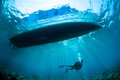 Underwater sunshine below the boat in Gorontalo, Indonesia. Royalty Free Stock Photo
