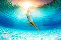 Underwater swimming and reflection in water Royalty Free Stock Photo
