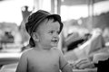 Undressed baby in panama looks aside Royalty Free Stock Photo