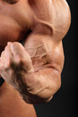 Undressed bodybuilder demonstrates biceps Stock Photos