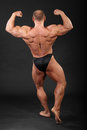 Undressed bodybuilder shows muscles Stock Image