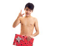Undressed young man holding present Royalty Free Stock Photo