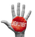 Unemployment stop concept raised hand with sign on the painted palm isolated on white background Royalty Free Stock Images
