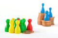 Unequal distribution of wealth group game figurines huddling around two cents while very few are on top stacks concept Stock Images