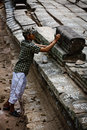UNESCO Restoration worker marks stones Angkor Wat Royalty Free Stock Photography