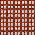 Uneven brick facede with crooked windows seamless pattern