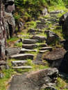 Uneven rock stairs along a cliff Royalty Free Stock Photos