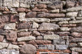 Uneven stone wall detail shot of an with various colors shapes and sizes Royalty Free Stock Images