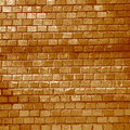 Uneven surface of the brick wall Stock Images
