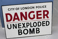 Unexploded bomb sign old antique london police warning of danger from an wwii Stock Photo