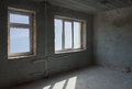 Unfinished room interior corner of concrete with blue sky window Royalty Free Stock Image