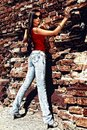 Unforgettable model standing near old wall. Stock Photos