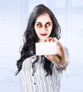 Unfresh female business zombie standing in modern holding business card when killing business stock cliches Stock Photos